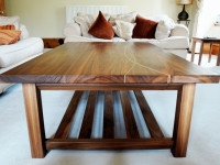 A bespoke coffee table hand made in Scotland from solid walnut and Scottish sycamore.