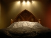 A king size bed in solid oak with Gothic hand carving