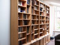 Large Oak bookcase with cupboards and natural waney edge worktop