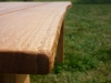 Outdoor oak table with a natural edge