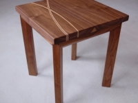 Bespoke walnut side table with entwined lines in sycamore