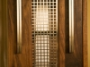 bespoke walnut bookcase with aluminium detailing